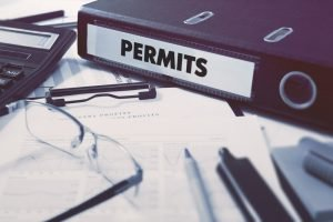 Permits - Ring Binder on Office Desktop with Office Supplies. Business Concept on Blurred Background. Toned Illustration.