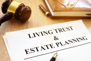 Living trust and estate planning form on a desk.