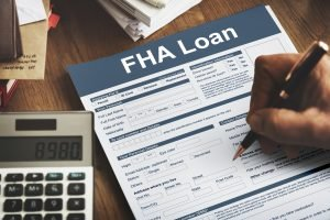 Image of a person filling out an FHA Loan Federal Housing Administration Lending