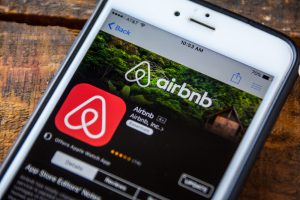 Airbnb app shown on smartphone