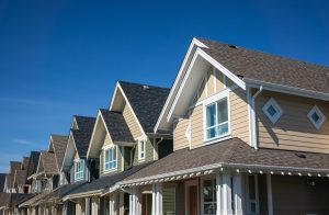 Image showing a row of newly constructed townhomes representing subdivision laws in Maryland.