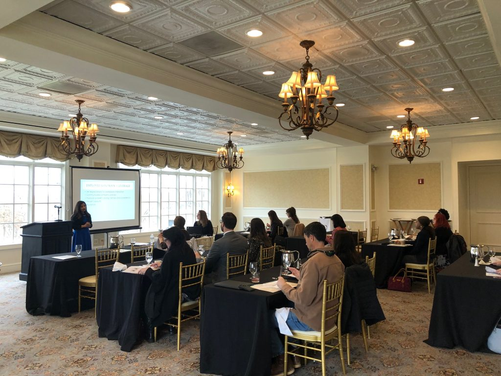 Natasha Nazareth and Ginny Cascio Bonifacino presenting to a group of professionals about the importance of employee handbooks and the latest info about employment law.
