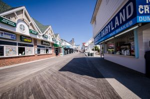 Ocean City, Maryland - April 3, 2018: Empty boardwalk with no people and closed restaurants and stores in early spring during a weekday. This is a slow time of year for Ocean City