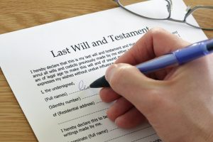 A hand Signing Last Will and Testament document