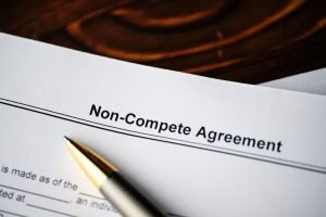 Legal document Non-Compete Agreement on paper close up.