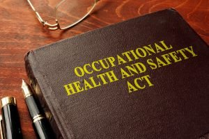 Image of OSHA policy book representing OSHA recommendations for unvaccinated employees.