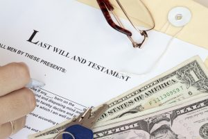 Image of last will and testament with money, keys and glasses symbolizing estate planning in MD, DC and VA.